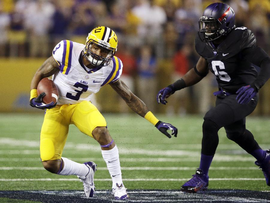 LSU wide receiver Odell Beckham (3) runs past TCU safety Elisha Olabode (6) during the first half of an NCAA college football game, Saturday, Aug. 31, 2013, in Arlington, Texas. (AP Photo/LM Otero)