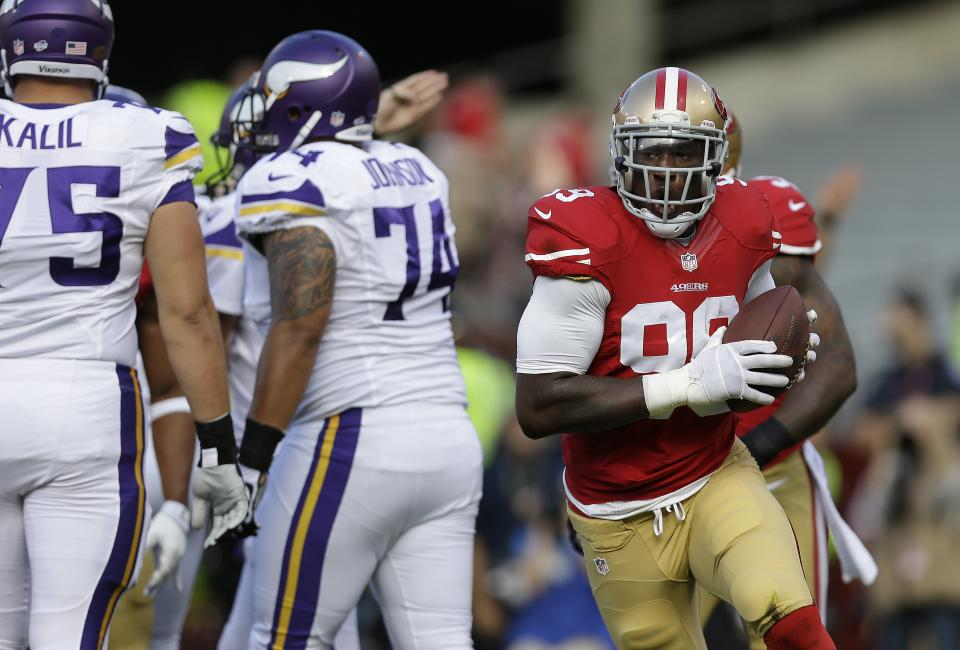 Kaepernick, 49ers' defense strong in 34-14 win