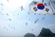 A South Korean national flag flutters aboard a tourship during a tour of the Korean-controlled islands in the Sea of Japan (East Sea) -- known as Takeshima in Japan and Dokdo in South Korea. A group of South Korean lawmakers were set Tuesday to visit the islands, a move likely to stoke tensions with Tokyo still more