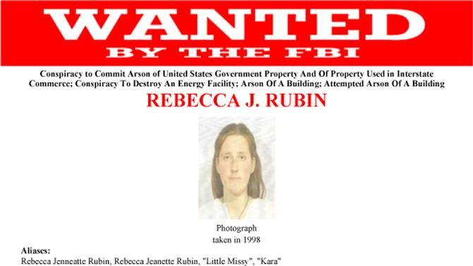 This undated wanted poster from the FBI shows Rebecca Rubin, who turned herself in to authorities on the Washington-Canada border on Thursday, Nov. 29. 2012. Authorities said Rubin is one of three remaining fugitives from a cell of the Earth Liberation Front known as The Family and based in Eugene, Ore. Ten others from the gorup have been convicted in a string of 20 arsons across the West from 1996 to 2001 that caused $40 million in damages. (AP Photo/FBI)