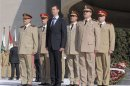 File handout photo of Syria's President Assad standing with Fahad Jassim al-Freij and Daoud Rajha in Damascus