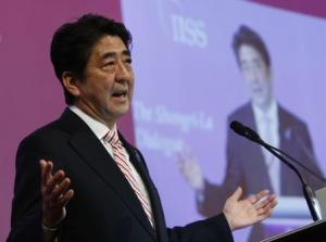 Japan's Prime Minister Shinzo Abe delivers the opening keynote address for the 13th IISS Asia Security Summit: The Shangri-La Dialogue, in Singapore