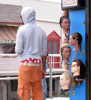 In a June 6, 2013 photo, a young man wears saggy pants on the Wildwood, N.J. boardwalk. Wildwood is set to pass a law Wednesday, June 12, 2013 regulating how people dress on its boardwalk, including a prohibition on pants that sag more than 3 inches below the hips, exposing either skin or underwear. Mayor Ernest Troiano said Wildwood has been inundated with complaints from tourists upon whose money the popular beach town depends for its survival. (AP Photo/Wayne Parry)