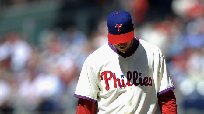 Philadelphia Phillies' Roy Halladay reacts after a home run hit by Miami Marlins' Adeiny Hechavarria in the third inning of a baseball game on Sunday, May 5, 2013, in Philadelphia. (AP Photo/Michael Perez)
