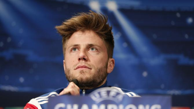 Ajax Amsterdam's Lasse Schone attends a news conference a day before of their Champions League soccer match against Paris St Germain at the Parc des Princes stadium in Paris