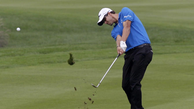 Adam Scott of Australia hits the ball at 18th fairway during the first round of the HSBC Champions golf tournament Shanghai, China Thursday, Nov. 3, 2011. (AP Photo/Eugene Hoshiko)