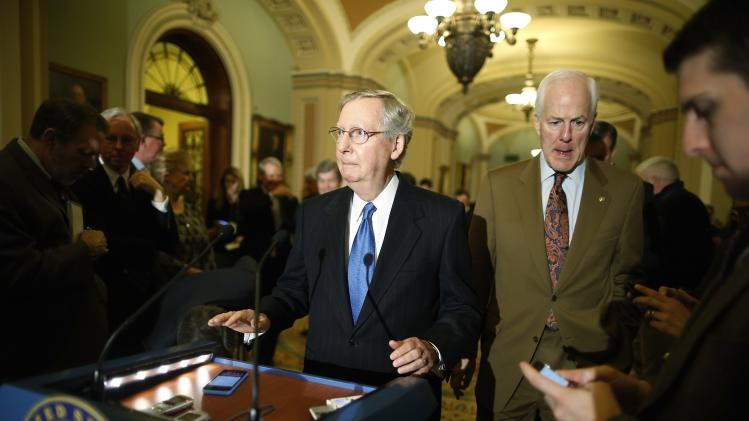 McConnell and Cornyn arrive to take questions from reporters after the weekly Republican caucus luncheon at the U.S. Capitol in Washington