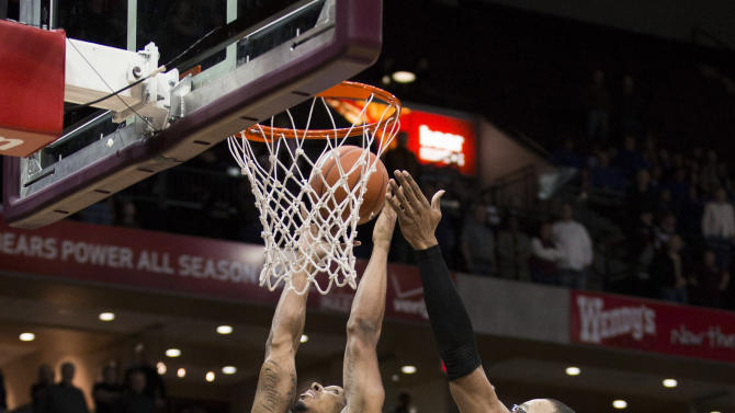 Missouri State forward Drew Wilson (15) grabs a rebound over Creighton center Gregory Echenique (00) during the first half of an NCAA college basketball game Friday, Jan. 11, 2013, in Springfield, Mo.  (AP Photo/David Welker)