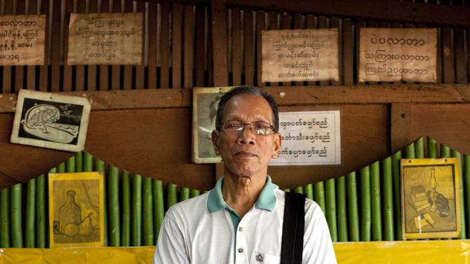 """In this picture taken on Wednesday, Nov. 14, 2012, Hla Shwe, a political prisoner who spent 25 years behind bars, poses in Yangon, Myanmar. """"This trip is not only for Burma,"""" said U Hla Shwe, 75. """"America wants to balance power between China and Southeast Asian nations."""" Word of U.S. President Barack Obama's historic visit has spread quickly around Yangon, which is readying itself with legions of hunched workers painting fences and curbs, pulling weeds and scraping grime off old buildings in anticipation of the president's Monday arrival.(AP Photo/Gemunu Amarasinghe)"""