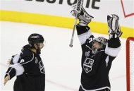 Kings goalie Quick (R) and Doughty celebrate their win over the Devils in Game 6 to win the NHL Stanley Cup hockey final in Los Angeles