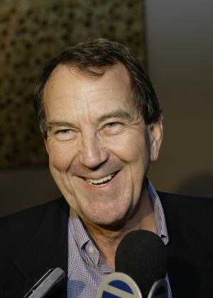 FILE - This Dec. 22, 2006, file photo shows University of Michigan football coach Lloyd Carr smiling as his team arrives at a hotel in Los Angeles, for the Rose Bowl game.  Carr is among the 16 players and coaches selected for induction into the College Football Hall of Fame. (AP Photo/Damian Dovarganes)