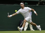 Fabio Fognini of Italy returns a shot  to Roger Federer of Switzerland during a second round men&#39;s singles match at the All England Lawn Tennis Championships at Wimbledon, England, Wednesday, June 27, 2012. (AP Photo/Kirsty Wigglesworth)