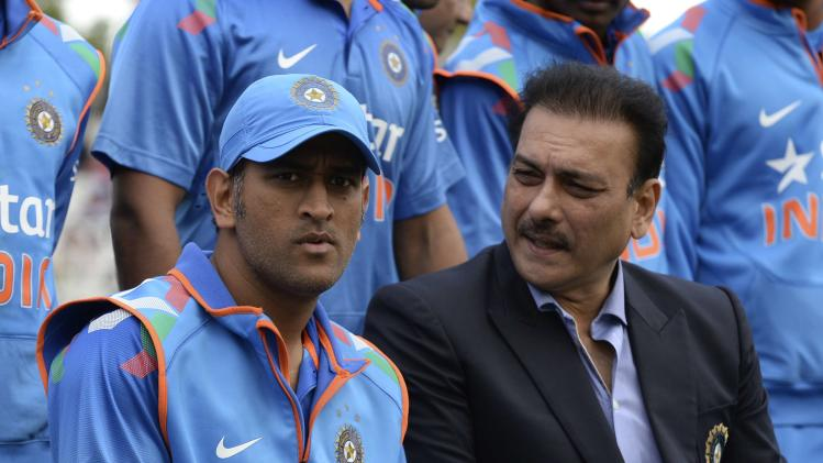 India's Dhoni sits with Shastri for a team photo before the third one-day international cricket match against England at Trent Bridge cricket ground, Nottingham