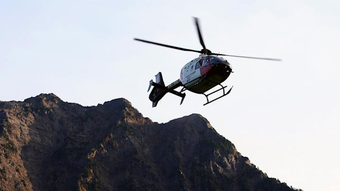 An Airlift Northwest helicopter transports an injured woman to a hospital on Monday, July 6, 2015 near the Big Four trail head in Verlot, Wash.  One person has been killed and at least four others injured by the partial collapse of ice caves northeast of Seattle that authorities had previously warned were dangerous, especially because of the unseasonable heat the region has experienced.  (Genna Martin/The Herald via AP) MANDATORY CREDIT ; TV OUT