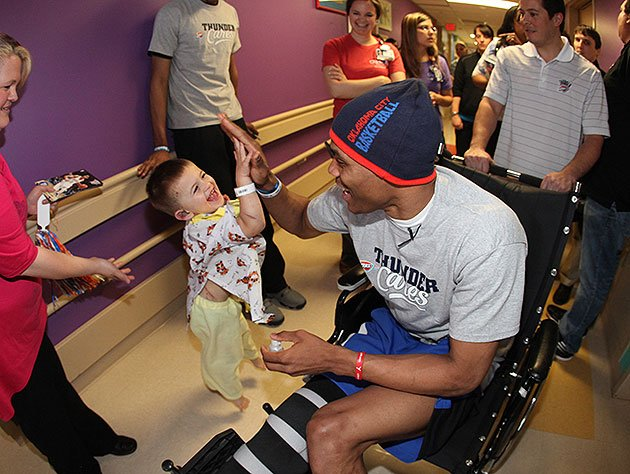 Russell-westbrook-high-fives-a-young-tornado-victim-at-childrens-hospital-at-ou-medical-center.-nba-photos-getty-images