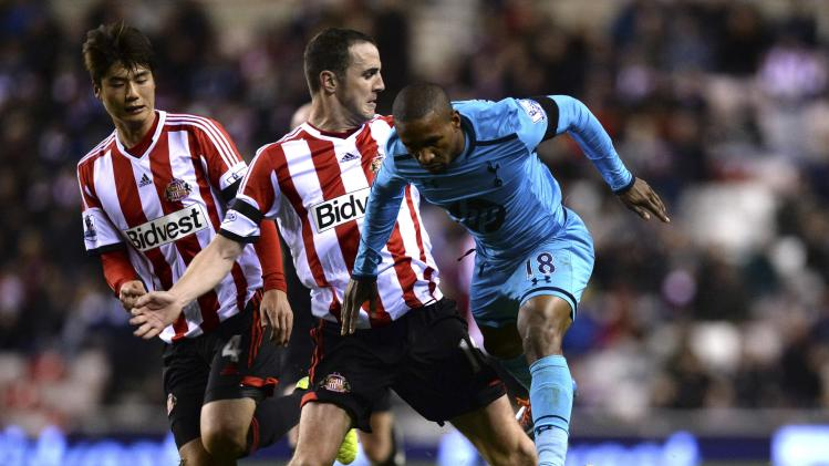 Sunderland's O'Shea challenges Tottenham Hotspur's Defoe during their English Premier League soccer match at the Stadium of Light in Sunderland