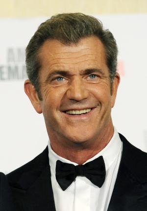 """FILE - In this Oct. 14, 2011 file photo, Mel Gibson poses at the 25th American Cinematheque Award benefit gala honoring actor Robert Downey Jr., in Beverly Hills, Calif. The future of a film about the ancient Jewish warrior Judah Maccabee, is uncertain after a disagreement between producer Gibson and screenwriter Joe Eszterhas. Warner Bros. spokesman Paul McGuire said Friday that the studio is """"analyzing what to do with the project."""" (AP Photo/Chris Pizzello, File)"""