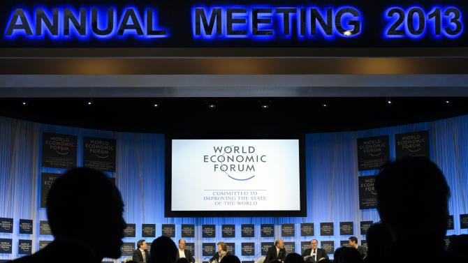 Participants listen a panel session in the Congress Hall the last day of  the 43rd Annual Meeting of the World Economic Forum, WEF, in Davos, Switzerland, Saturday, Jan. 26, 2013. (AP Photo/Keystone/Laurent Gillieron)