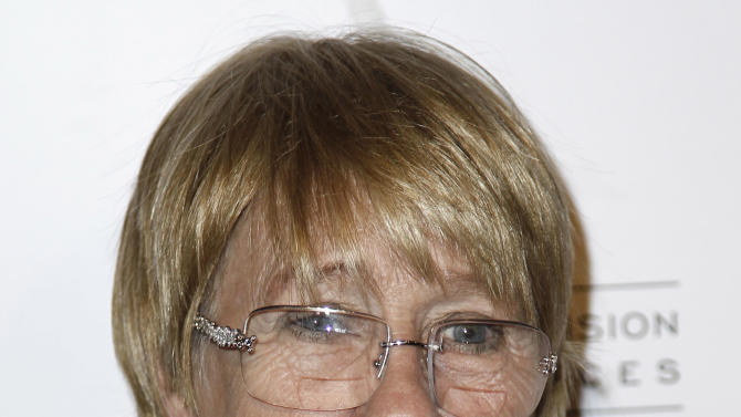 """In this March 1, 2012 photo, Kathryn Joosten arrives at the Academy of Television Arts and Sciences 21st Annual Hall of Fame Gala in Beverly Hills, Calif. Joosten, a veteran character actress who played the crotchety, nosey Karen McCluskey on ABC's """"Desperate Housewives,"""" has died. She was 72. Publicist Nadine Jolson said Joosten, who had battled lung cancer for years, died Saturday, June 2, 2012, in Los Angeles. (AP Photo/Matt Sayles)"""