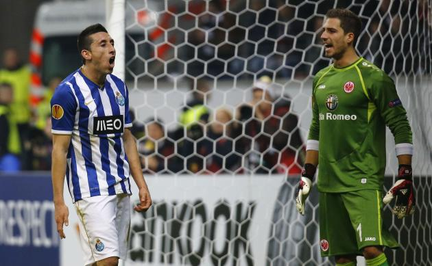 Porto's Herrera reacts after missing a chance to score against Eintracht Frankfurt's goalkeeper Trapp during their Europa League soccer match in Frankfurt