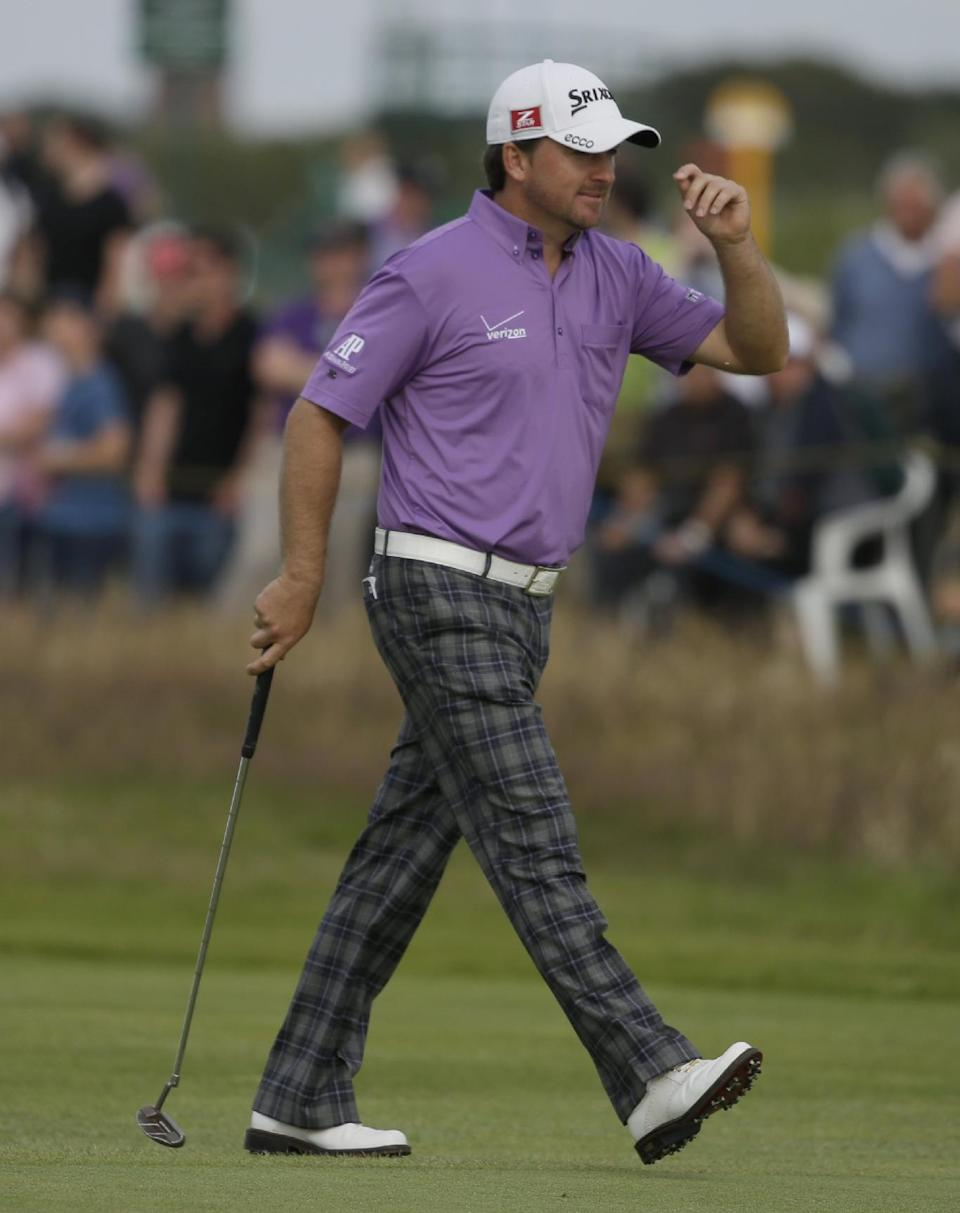 Graeme McDowell of Northern Ireland reacts after putting on the 15th green at Royal Lytham & St Annes golf club during the third round of the British Open Golf Championship, Lytham St Annes, England, Saturday, July 21, 2012. (AP Photo/Chris Carlson)