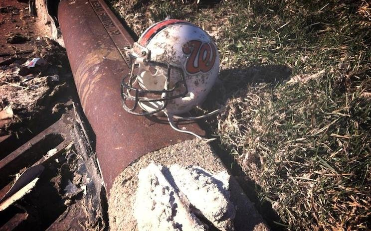 A Washington football helmet sits among debris after a tornado hit the Illinois town — Facebook