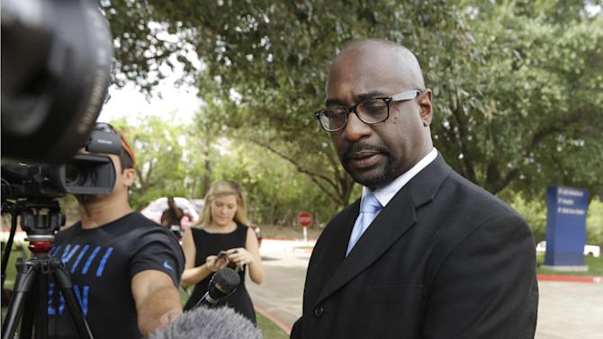 Eric Williams, candidate for U.S. Congress District 30, pauses as he speaks to reporters outside of Texas Health Presbyterian Hospital Dallas about the death of Ebola patient Thomas Eric Duncan, Wednesday, Oct. 8, 2014, in Dallas. Williams is calling on Gov. Rick Perry to begin an investigation into the treatment of Duncan and the care he received at the hospital. (AP Photo/LM Otero)