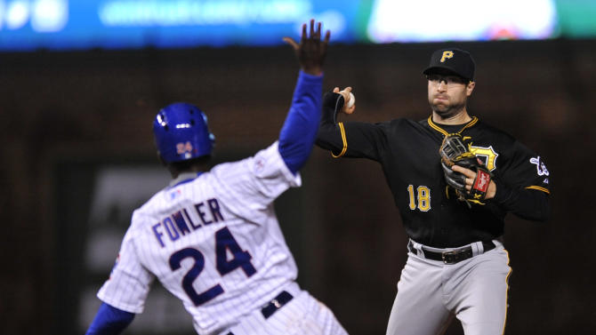 Pittsburgh Pirates second baseman Neil Walker (18), throws to first base after forcing out Chicago Cubs' Dexter Fowler (24), at second base during the fIfth inning of an MLB baseball game Monday, April 27, 2015 in Chicago. (AP Photo/Paul Beaty)