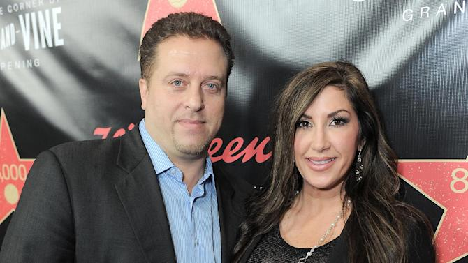 """FILE - This Nov. 30, 2012 file photo originally released by Walgreens shows Chris Laurita, left, and his wife Jacqueline Laurita, of """"The Real Housewives of New Jersey,"""" at Walgreens 8000th Store Opening in Los Angeles. A Paramus man claims Jacqueline and Christopher Laurita and Giuseppe """"Joe"""" Gorga attacked him as cameras rolled in a hair salon in Ridgewood on Saturday, March 30. John Karagiorgis filed a complaint, accusing the three of simple assault and making terroristic threats. The reality stars responded with their own complaints. (AP Photo/Walgreens, Jordan Strauss, file)"""