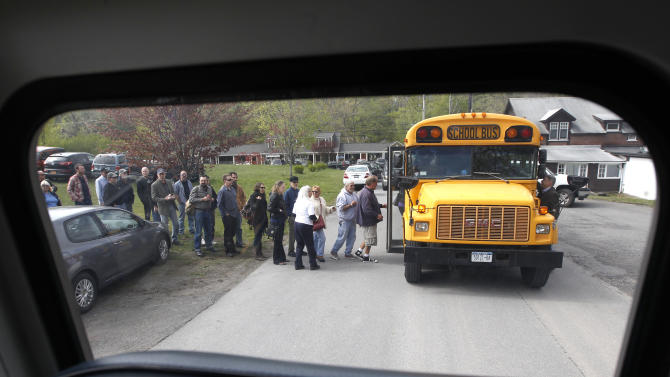 People board buses to go to a wake for musician Levon Helm at his home in Woodstock, N.Y., on Thursday, April 26, 2012. Helm, a former member of The Band, four-time Grammy Award winner and member of the Rock and Roll Hall of Fame died last week at age 71 after a battle with cancer. (AP Photo/Mike Groll)