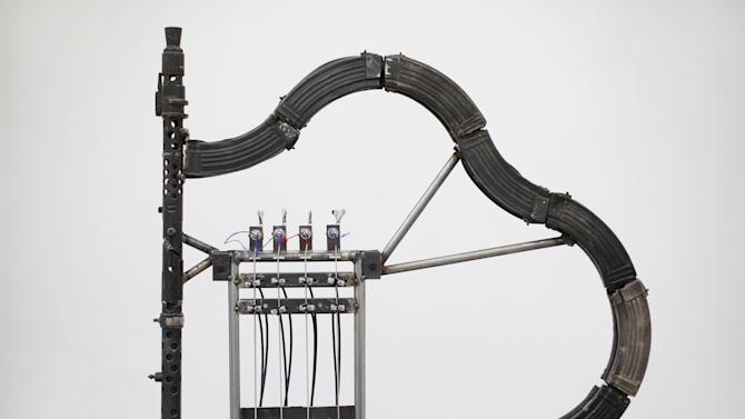 Mexican Artist Pedro Reyes Rehearses Using Musical Instruments He Has Created From Weapons Confiscated From Mexican Cartels
