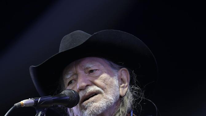 Willie Nelson performs at the New Orleans Jazz and Heritage Festival in New Orleans, Friday, May 3, 2013. (AP Photo/Gerald Herbert)