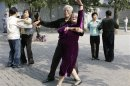 File photo of elderly people dancing during a morning exercise session at the Temple of Heaven park in Beijing