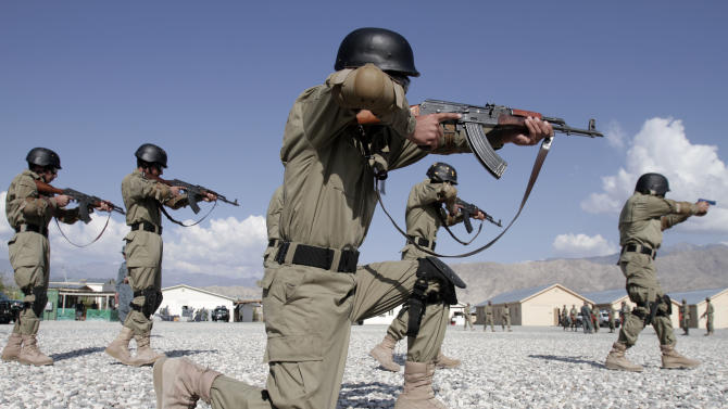 Afghan local policemen demonstrate their skills during a training exercise at the Laghman police academy in Laghman province east of Kabul, Afghanistan, Tuesday, Oct 23, 2012. Over 150 Local police are being given training at the Laghman Academy. (AP Photo/Rahmat Gul)