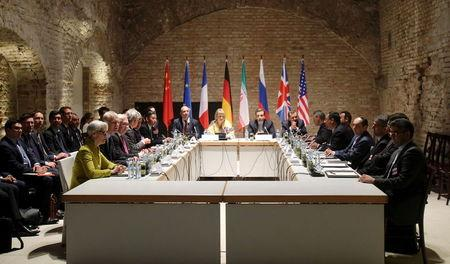 Negotiators of Iran and six world powers face each other at a table in the historic basement of Palais Coburg hotel in Vienna