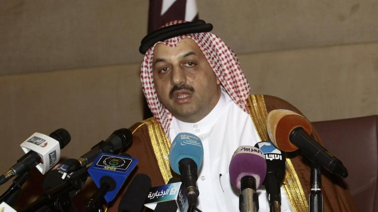Khalid bin Mohamed al-Attiyah answers a question during a news conference in Algiers