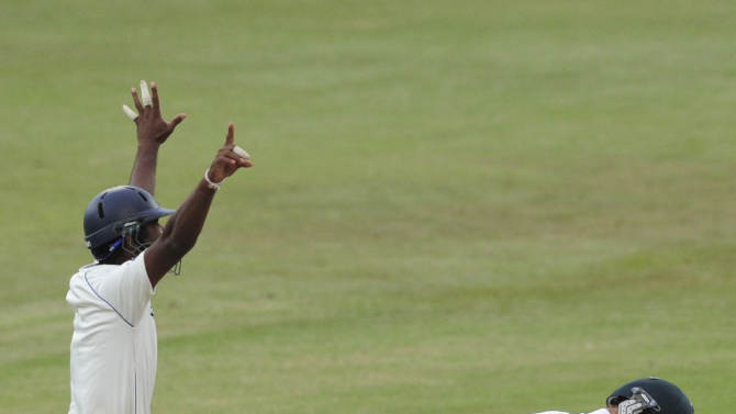 Sri Lankan players celebrate winning there first test in Sout Africa as Marchant de Lange, right of South Africa is bowled out by Rangana Herath, unseen of Sri Lanka during their second five-day test in Durban, South Africa, Thursday, Dec. 29, 2011 (AP Photo/Str)