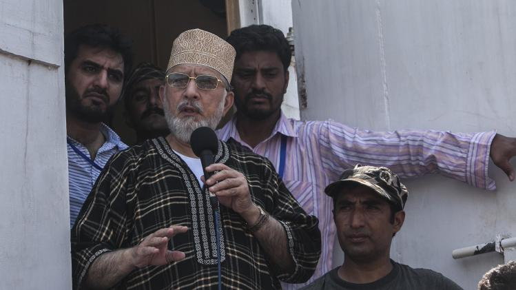 Tahir ul-Qadri, Sufi cleric and leader of political party Pakistan Awami Tehreek (PAT),addresses supporters during the Revolution March in Islamabad