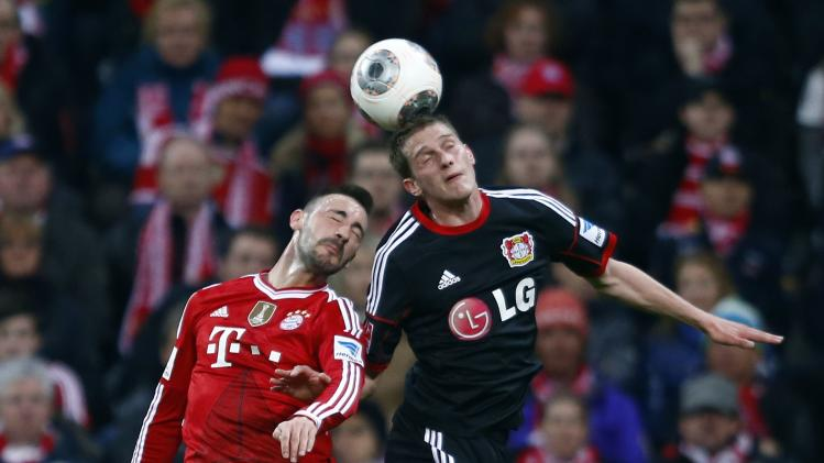 Leverkusen's Bender challenges Munich's Contento during their German first division Bundesliga soccer match in Munich