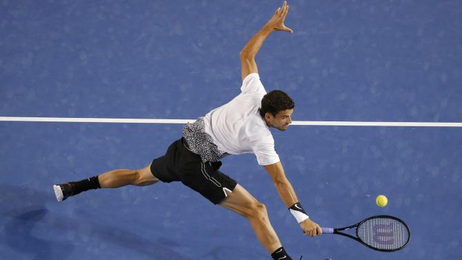 Grigor Dimitrov of Bulgaria stretches to hit a return against Andy Murray of Britain during their men's singles fourth round match at the Australian Open 2015 tennis tournament in Melbourne