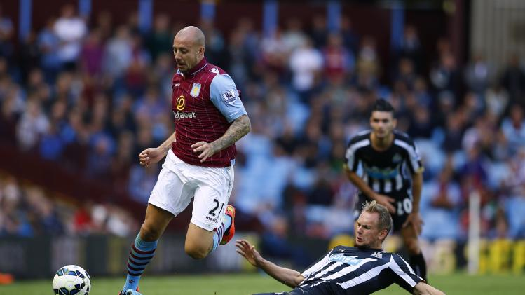 Aston Villa's Hutton is challenged by Newcastle United's de Jong during their English Premier League soccer match at Villa Park in Birmingham