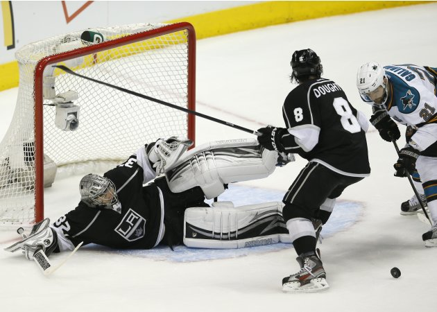 Kings goalie Quick makes a save on Sharks left wing Galiardi in the during Game 5 of their NHL Western Conference semifinals playoff in Los Angeles