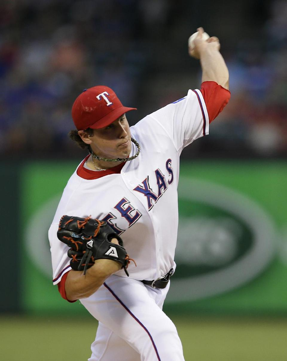 Texas Rangers starting pitcher Derek Holland works against the Oakland Athletics in the first inning of a baseball game, Friday, Sept. 13, 2013, in Arlington, Texas. (AP Photo/Tony Gutierrez)