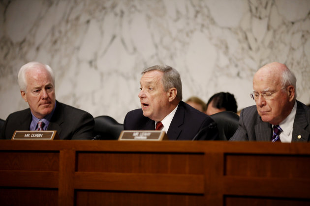 "FILE - In this Tuesday, June 28, 2011 file photo, Sen. Richard Durbin, D-Ill., center, flanked by Sen. John Cornyn, R-Texas, left, and Sen. Patrick Leahy, D-Vt., speaks during a meeting on Capitol Hill in Washington. The Senate holds its second hearing Tuesday, Feb. 12, 2013, on gun curbs since the December 2012 shooting deaths of 20 first-graders in Newtown, Conn. This time, a Senate Judiciary subcommittee is examining the constitutionality and effectiveness of federal firearms limits. ""We need to keep guns out of the hands of criminals and those who are mentally unstable,"" Durbin, D-Ill., said in a brief interview Monday, Feb. 11, 2013. ""I hope everyone will acknowledge what within our Constitution is not only an individual right to bear arms, but the collective right of Americans to be safe."" (AP Photo/Charles Dharapak, File)"