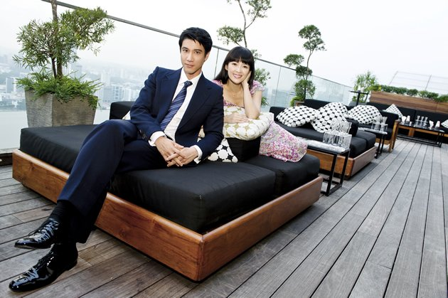 Actress Zhang Ziyi poses with co-star Wang Leehom at Sands SkyPark – Marina Bay Sands.