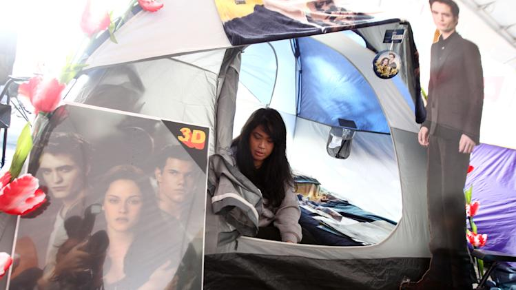 "Joanne Lassiter, of Los Angeles, is seen in her tent at the Twilight fan camp ahead of the world premiere of ""The Twilight Saga: Breaking Dawn - Part 2"" on Friday, Nov. 9, 2012 in Los Angeles. The premiere will be held Nov. 12. (Photo by Matt Sayles/Invision/AP)"