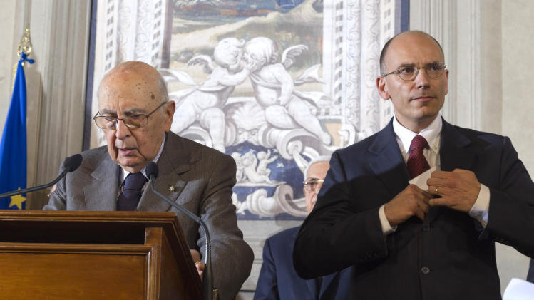Italian premier-designate Enrico Letta, right, and Italian President Giorgio Napolitano meet the media at the Quirinale presidential palace, in Rome, Saturday, April 27, 2013. Italy has finally has a new government, a coalition of Berlusconi's forces and center-left rivals who forged an unusual alliance to break a two-month stalemate following inconclusive elections. Enrico Letta, a center-left leader, will be premier in the government, which marks the latest political comeback by Silvio Berlusconi. (AP Photo/Domenico Stinellis)