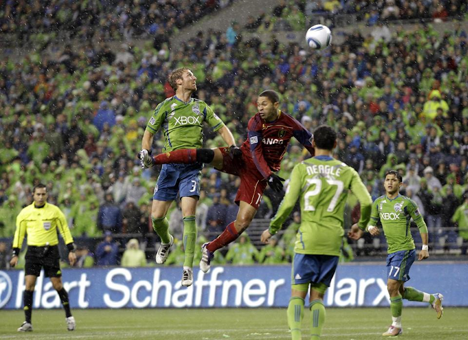 Real Salt Lake's Alvaro Saborio, center right, and Seattle Sounders' Jeff Parke, center left, watch the ball after a header during the first half of an MLS playoff soccer match, Wednesday, Nov. 2, 2011, in Seattle. (AP Photo/Ted S. Warren)