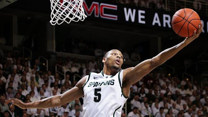Michigan State's Adreian Payne (5) pulls down a rebound against Indiana during the first half of an NCAA college basketball game, Tuesday, Feb. 19, 2013, in East Lansing, Mich. (AP Photo/Al Goldis)