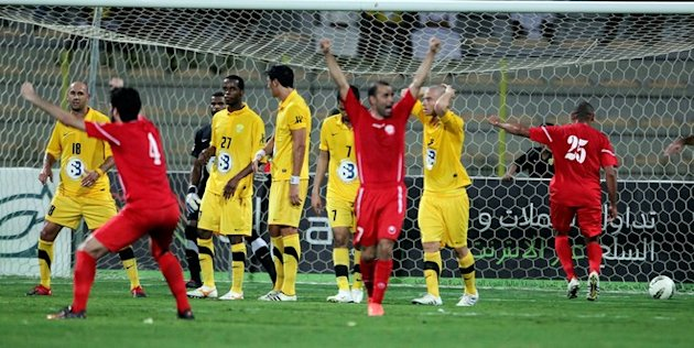 Bahrain's Al-Muharraq Club Players AFP/Getty Images